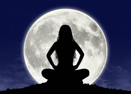 20669741-silhouette-of-a-young-beautiful-woman-with-long-hair-in-meditation-posture-with-the-full-moon-on-the
